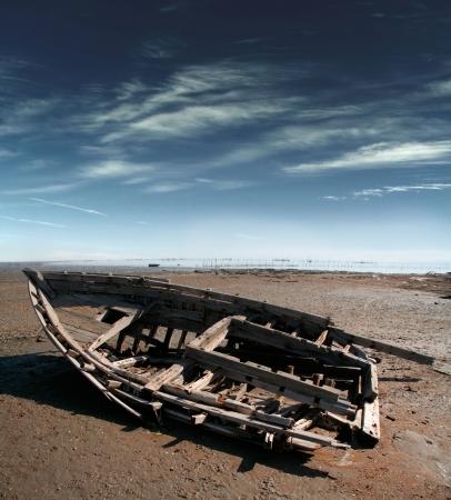 Old broken boat on the coast of Persian Gulf, Iran photo