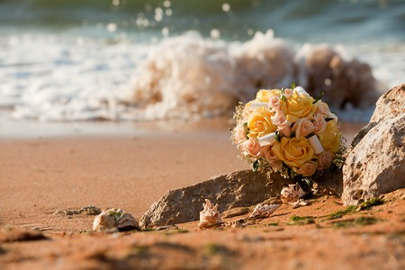 bridal bouquet on the beach against the backdrop of water