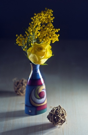 Ranunculus in colore vase with mimosa Stock Photo - 13322977