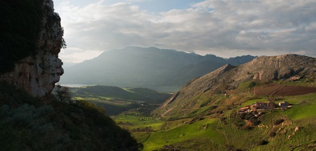 Panoramic shot on beautiful mountains, clouds and green valley of Caccamo  photo