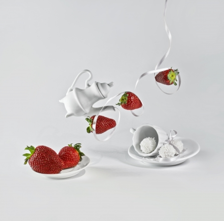 levitating: Levitating strawberry with white ribbon and small decorative dishes
