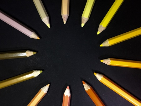 artistic: The circle of pencil colours on black background