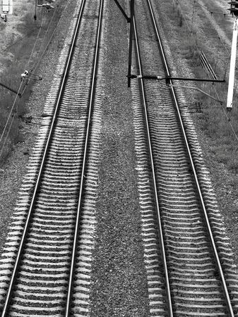 background, blue, direction, electric, forward, green, hub, industrial, industry, infrastructure, iron, journey, landscape, line, logistic, metal, move, multiple, nature, nobody, outdoor, perspective, platform, power, rail, railroad, rails, railway, road, rush, sky, station, steel, sunset, track, tracks, traffic, train, transit, transport, transportation, travel, view, way Banco de Imagens