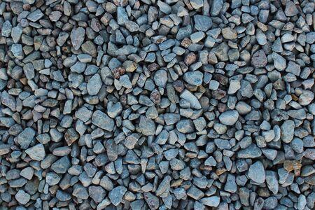 gray cracked granite rubble stones texture background