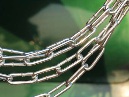 chrome chain hanging loosely close-up background for magazine