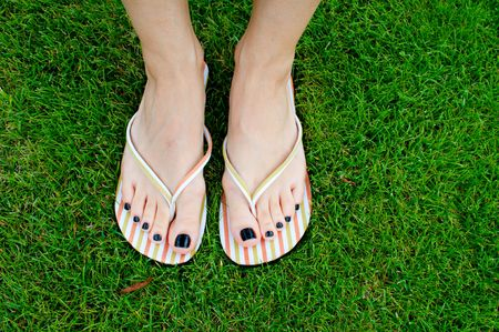 Female feet relaxing in the grass photo