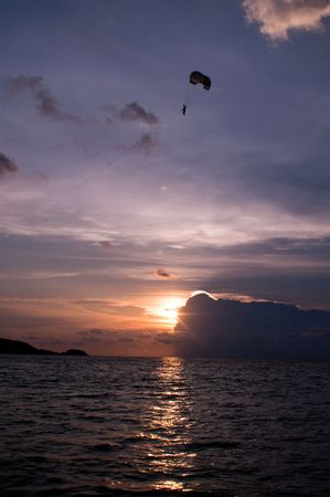 sunset paragliding on phuket island in thailand photo
