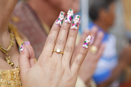 put the palms of the hands together in salute,Begging in Thailand Stock Photo