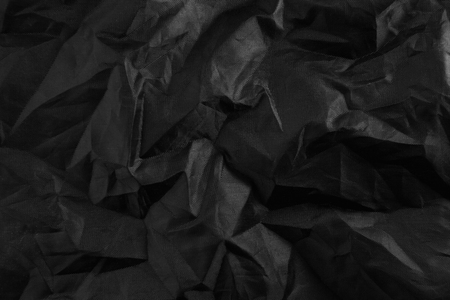 background crumpled of black cloth. texture Stock Photo