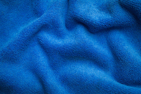 abstract texture of draped blue velvet background