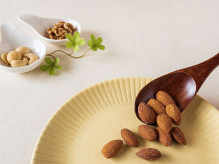 Almonds in yellow dish