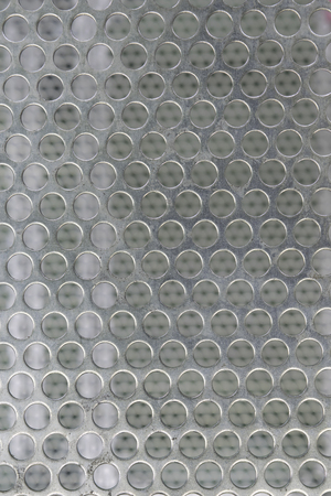 grating: Steel grating texture bokeh