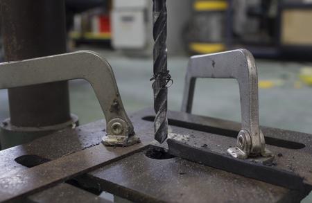 drilling machine: Drilling machine working on flat steel plate.