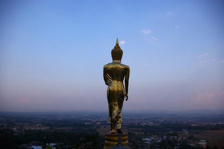 praye: back of golden buddha statue Stock Photo