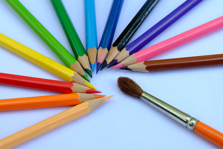 many different colored pencils with round paint brush photo