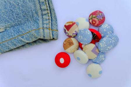 large group of items: Fabric buttons with a part of blue jeans