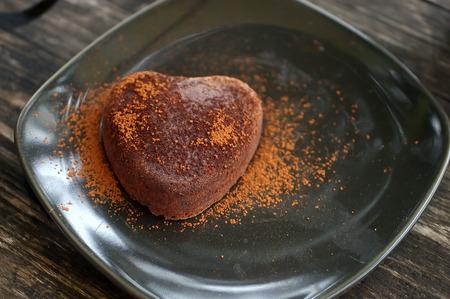 Chocolate cake on black plate photo