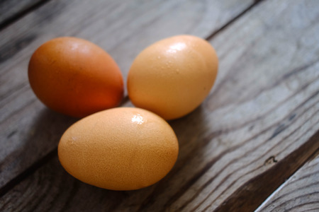 three egg on the wooden table photo