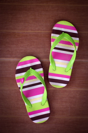 coloful: coloful slippers on the wooden floor Stock Photo