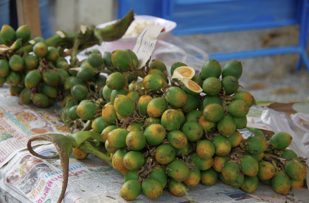 raw betel nut sold in the local market photo