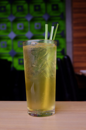 sour grass: Fresh lemon grass water healthy drinks on wooden table, Thai herbal drinks Stock Photo