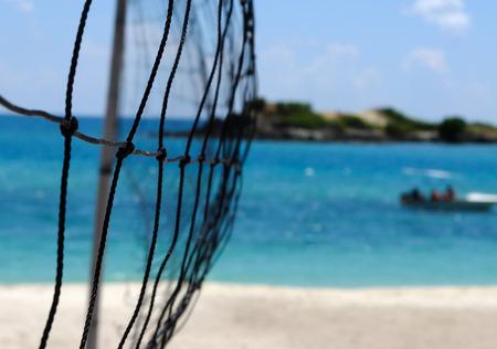 volleyball net: Beach volleyball net beside the sea Stock Photo