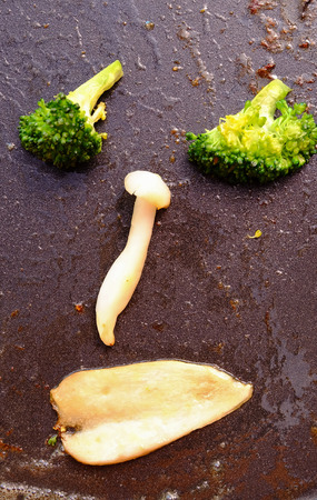 chinese food: fried fresh vegetables arrange a face on the pan Stock Photo