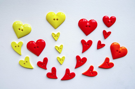 arranged: many heart shape buttons arranged on drawing paper