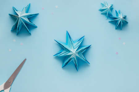 Simple origami 3D Christmas tree. Step 20. Match the details from the largest at the bottom to the smallest at the top. You can use glue to hold it in place or leave it as it is to keep the tree lush.