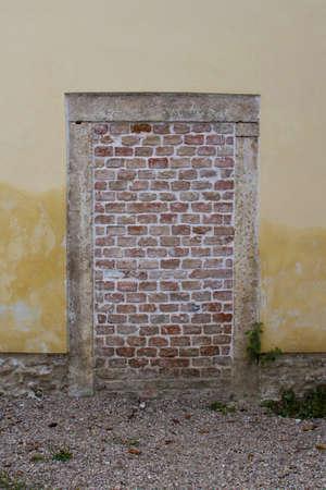 Old urban bricked entrance door 免版税图像