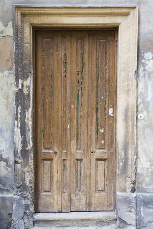 Old urban wooden entrance door