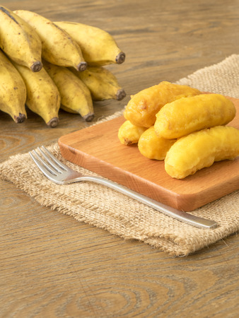 fritters: Fried banana fritters on chopping board