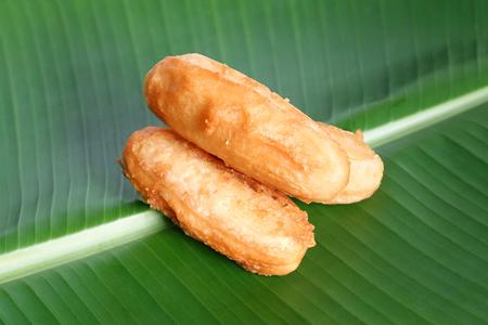 banana: Fried banana fritters on banana leaf