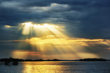 A heaven rays of sunshine on river Standard-Bild