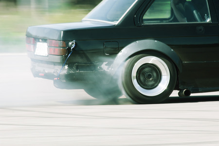 burnout: Car Drifting with Burnout Wheel Stock Photo