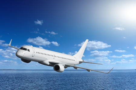 on off: passenger airplane flying over sea Stock Photo