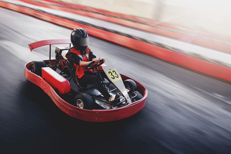 indoors: Go kart speed rive indor race oposition race Stock Photo