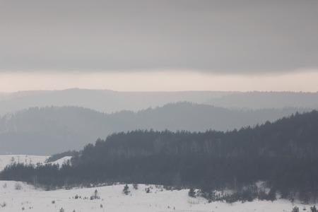 layered: Beautiful winter nature landscape. Layered forest mountains Stock Photo