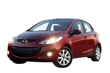 mazda: Red car Mazda 2 isolated on white background