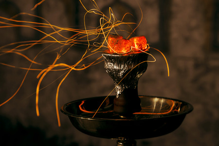 shisha hookah red hot coals. Sparks from breathe