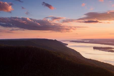 tilt views: Beautiful nature mountain landscape. Cloudy sunset over river Stock Photo