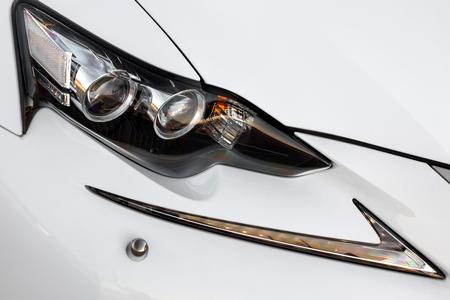 lexus auto: Headlight lamp of modern new white car