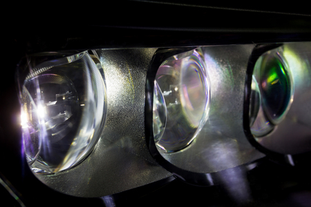acura: headlight of modern car, close-up macro photo