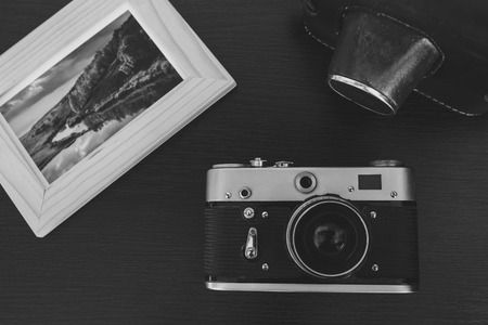 vintage retro frame: Retro vintage camera and photos in frame on wood background Stock Photo
