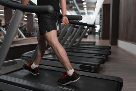 treadmill: People walkingin machine treadmill at fitness gym club Stock Photo