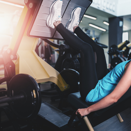apparatus: Woman working exercise on training apparatus in club Stock Photo