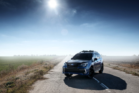 forester: Saratov, Russia - October 21, 2015: Blue car Subaru Forester standing on asphalt road at daytime