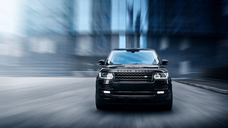 range of motion: Moscow, Russia - November 22, 2015: Premium car Land Rover Range Rover fast drive on road in the city at daytime;