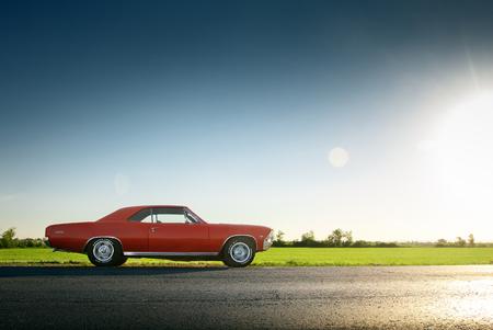 chevrolet: Saratov, Russia - June 07, 2015: Retro red car Chevrolet Malibu stay on asphalt road at sunset Editorial
