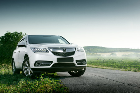 acura: Saratov, Russia - August 11, 2015: Modern car Acura MDX standing on road at sunset